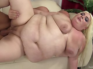 Mature blonde slut spreads her fat legs to get fucked by a long cock