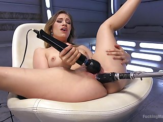 Good looking blonde Lyra Law plays with a vibrator and a fuck machine