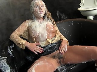 Zuzana Z sucking a large fake dick thru a gloryhole and moaning