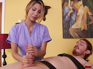 Sensual masseuse plays with the man's cock in a dominant way