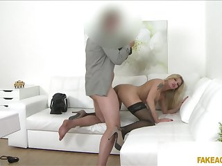 Fake-chested MILF shows up to an agent's office hoping to wow him