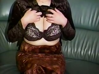 Horn-mad a bit plump amateur cam MILF plays with her huge knockers