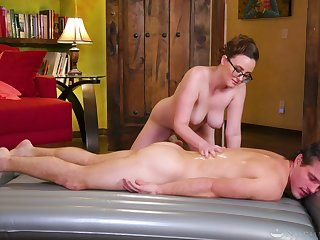 Erotic massage leads the busty masseuse to suck and fuck