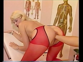 Fisting for nurse in red pantyhose