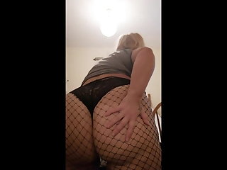 Big there in black fishnet pantyhose coupled with black panties