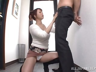 Cock hungry wife Riri Ouka drops on her knees to suck his perforate